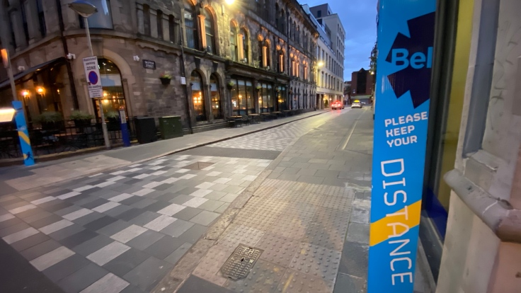 Empty street with Covid-19 signs during Lockdown 2 in Belfast, Northern Ireland