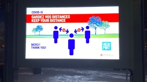 This is a photo of a poster informing to keep distance between people during the COVID-19 pandemic in Montreal, Canada.
